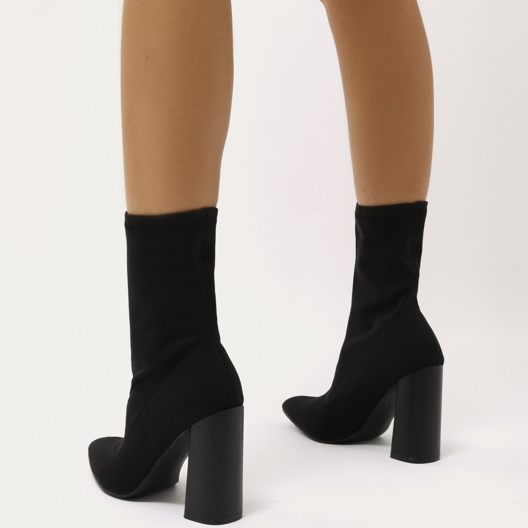 ab490883a181 Ultimate luxe looks in this tight sock fit stretch ankle booties. Featuring  a pointed toe and flared wooden effect stacked block heel.
